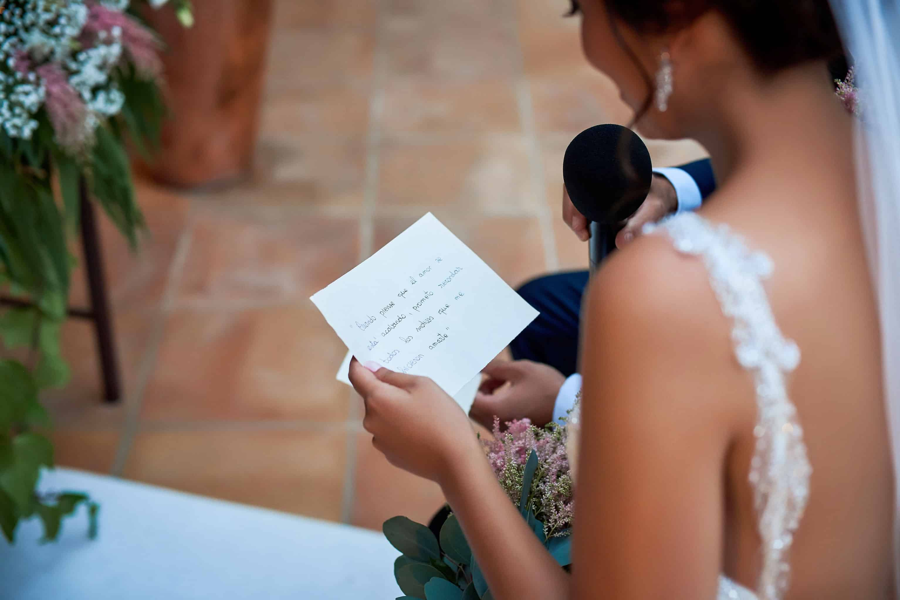 close up picture of a bride reading her wedding vows