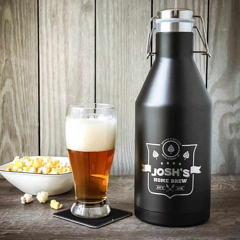 Personalized Growler next to a glass of beer - best groomsmen gift ideas