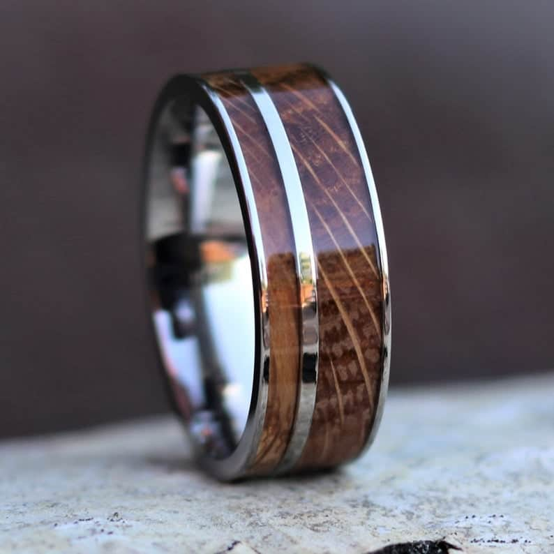 unique gift for fiance who is a whiskey lover: whiskey barrel ring